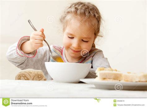 Child Eating Soup At Home Stock Photos   Image: 23528573