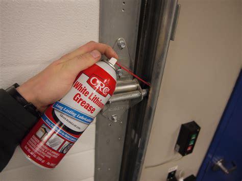 lubricating garage door proper garage door lubrication eastwood