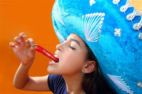 Mexican Girl Eating Red Hot Chili Pepper Stock Image