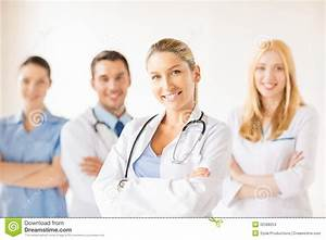 Female Doctor In Front Of Medical Group Stock Photo ...