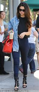 Selena Gomez puts a stylish spin on high-waist jeans and crop top with a $1500 Emilio Pucci bag ...