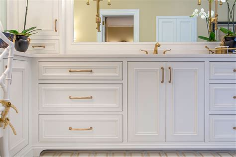 White Cabinets Bronze Hardware by White Bathroom Cabinets Chagne Bronze Finish Hardware