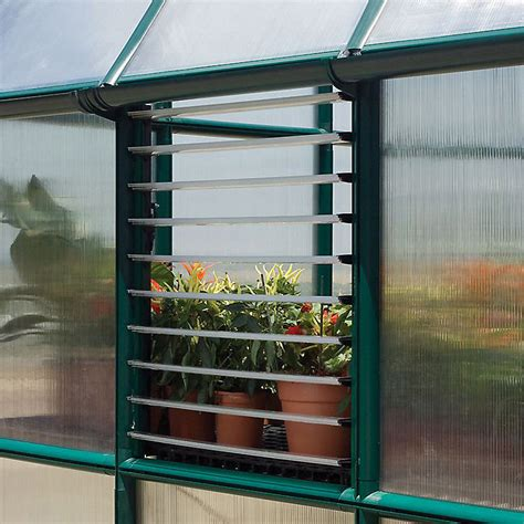 If you want your greenhouse to double as a workshop or studio, include large roof overhangs on the south side. Palram Plastic Greenhouse side louvre window | DIY at B&Q