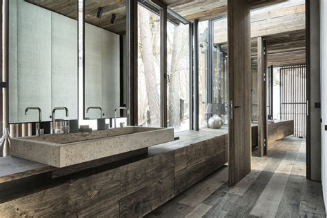 wood home interiors wood bathroom concrete sink modern home in the mountains