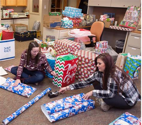 university wraps up gifts for 170 area children this