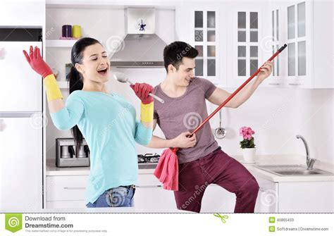 Happiness Couple After Cleaning The House Stock Photo