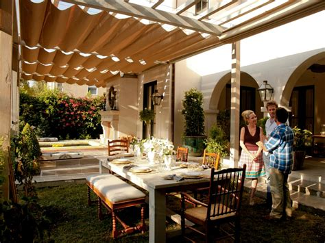 Elegant Backyard With Outdoor Dining Room And Pergola