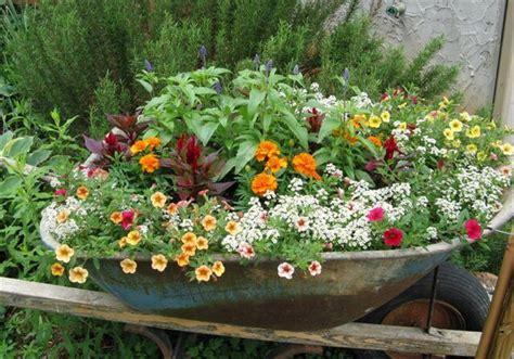 wheelbarrow planter ideas 10 diy wooden wheelbarrow planter diy to make