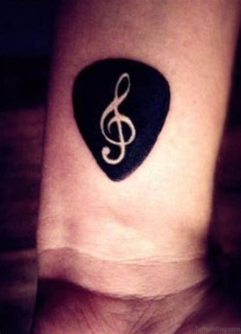 Cross Music Note Tattoo wrist tattoos 738 x 1024 · jpeg