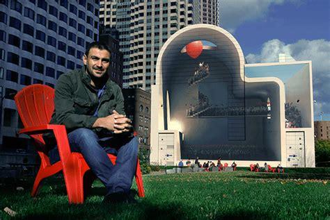 iranian artist mehdi ghadyanloo sits  front   mural