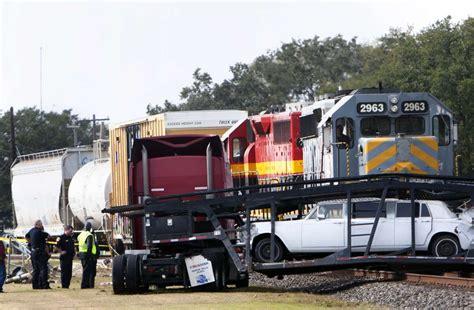 Train smashes big rig carrying Rolls Royce in Sugar Land