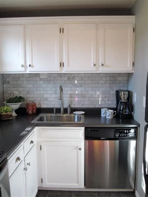 backsplash looksbest  whitecabinets anddark