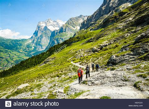 Direction Signs Alpine Hikes Alps Switzerland Stock Photo Hikers On The Eiger Trail Switzerland With The Grindelwald