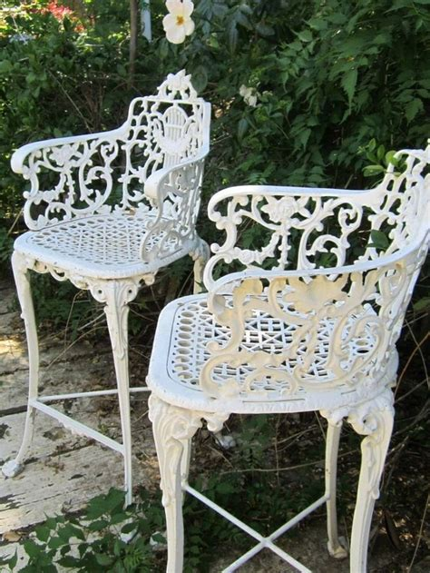 vintage white ornate wrought iron chair indoor