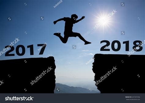 man jump  gap  hill stock photo