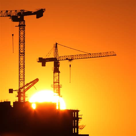 industrial construction cranes  building silhouettes