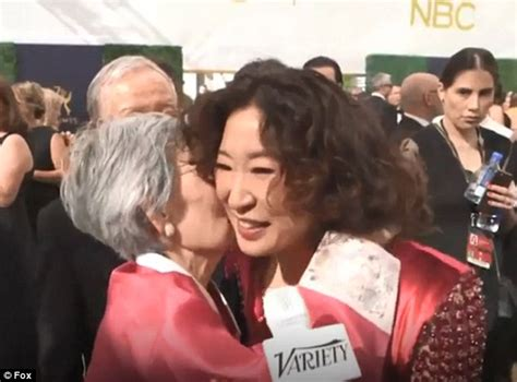 sandra oh mother sandra oh receives sweet smooch from her mom as she takes