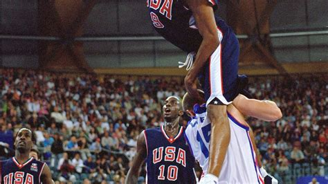 yahoo sports favorite olympic moment vince carter dunks  frederic weis orlando pinstriped post
