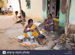 Indian Woman Cooking Dosa For People Outside A Rural ...