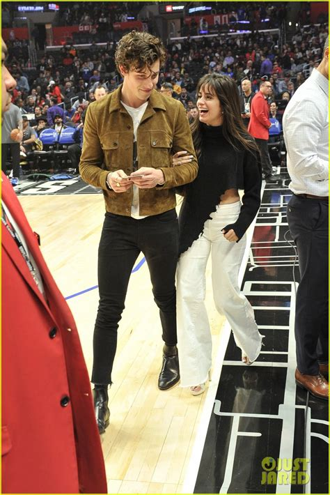 shawn mendes camila cabello share  smooch  clippers