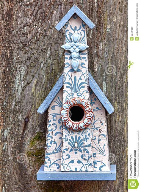 blue  white church birdhouse stock photo image