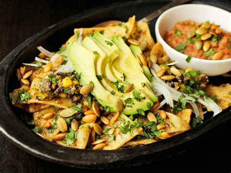 chilaquiles  pepitas charred corn  black beans