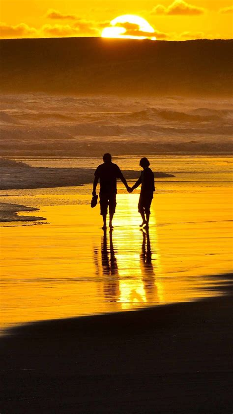 couple holding hands  beach iphone wallpaper iphone