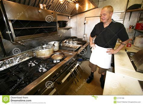 Chef At Work In Small Kitchen Stock Photo   Image: 21701186