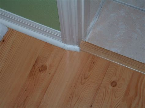 how to end laminate flooring at doorways laminate floor transitions doorway carpet vidalondon