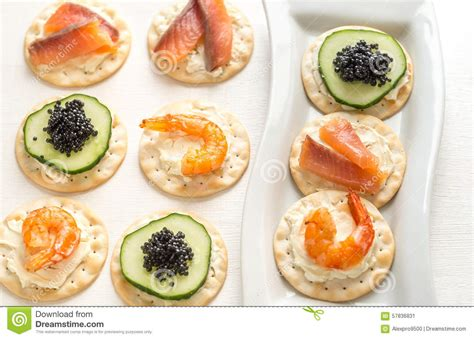 canapé 2places canape with seafood on the plate stock photo image 57836831