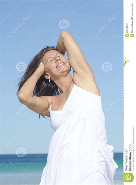 Senior Woman Beach Holiday Royalty Free Stock Images