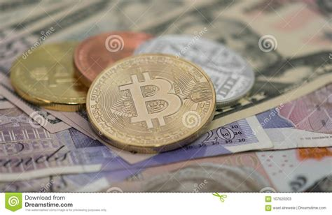 So, you've converted 1 pound sterling to 0.000025 bitcoin. Bitcoins With US Banknotes And British Banknotes, 20 Pounds Sterling, 10 Pound Sterling Notes ...
