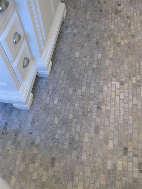 the cottage bathroom floor is 1 quot x2 silver travertine from