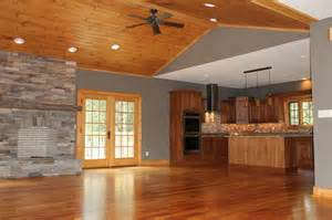 rustic heartpine floors with stacked stone fireplace vpc
