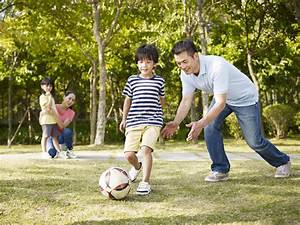Father Coaching Son To Play Soccer Stock Photo - Image of ...