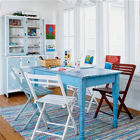 blue table multicolor chairs rug coastal colors