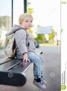 Toddler Boy Sitting On Bench On Bus Stop Stock Photo ...  Sitting
