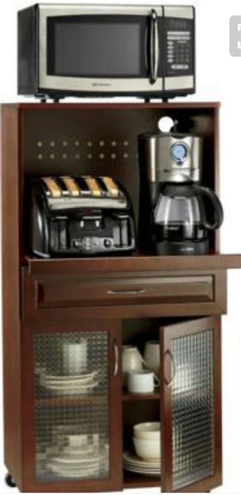 Place 1 teaspoon (or more to taste) instant coffee into hot water. Microwave/Toaster Oven Storage   Appliance cabinet