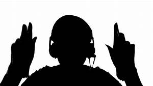 Silhouette of a girl listening to music on headphones ...