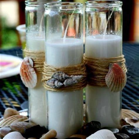 beach candles images  pinterest beach themes shells  beach centerpieces