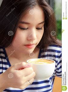 Woman Drinking Coffee In A Cafe Stock Photo - Image: 41635790