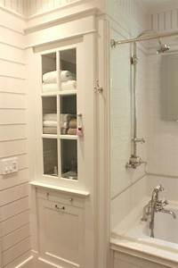 bathroom linen cabinet and tub surround with white subway With built in bathroom storage vanities