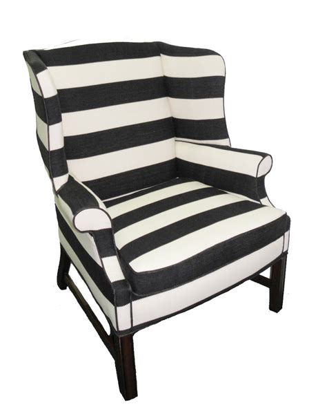 large upholstered black and white striped chair haute juice