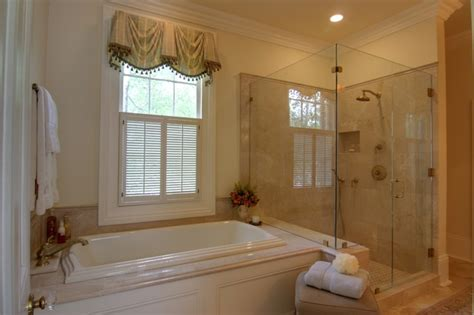 Elegant Master Bathroom With Custom Cabinetry & Lighting
