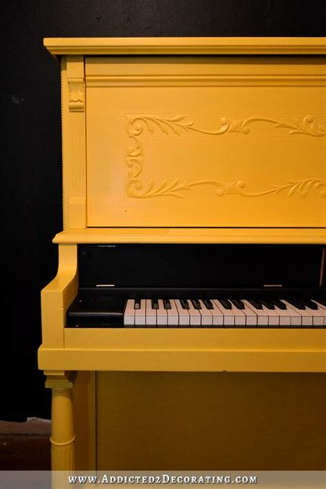 improved smiley face yellow painted upright piano
