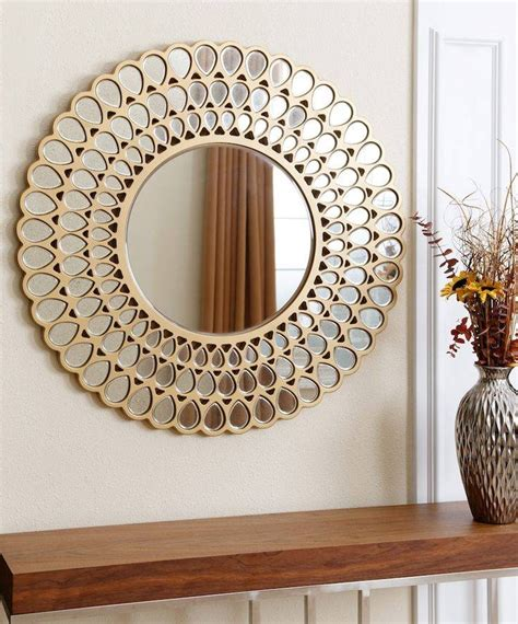 The sleek, smart and streamlined structure and golden powder coated frame accentuates the influences that tivoli has drawn from scandinavian designs and contemporary trends in wall decor. 15 Ideas of Decorative Round Wall Mirrors