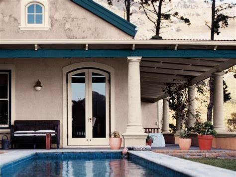 beige home exterior with deep blue trim hgtv