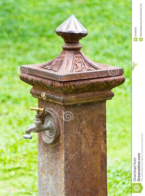 Water Hose Stand by Italian Style Faucet Royalty Free Stock Photography