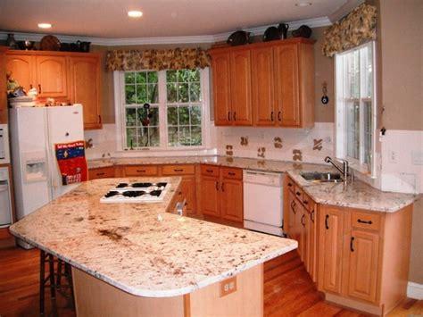 floratta white granite  light wood cabinets