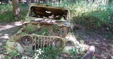 jeep sunk   ground   woods